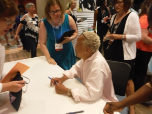 AWW Exec Sharon Short greets Nikki Giovanni at her book signing